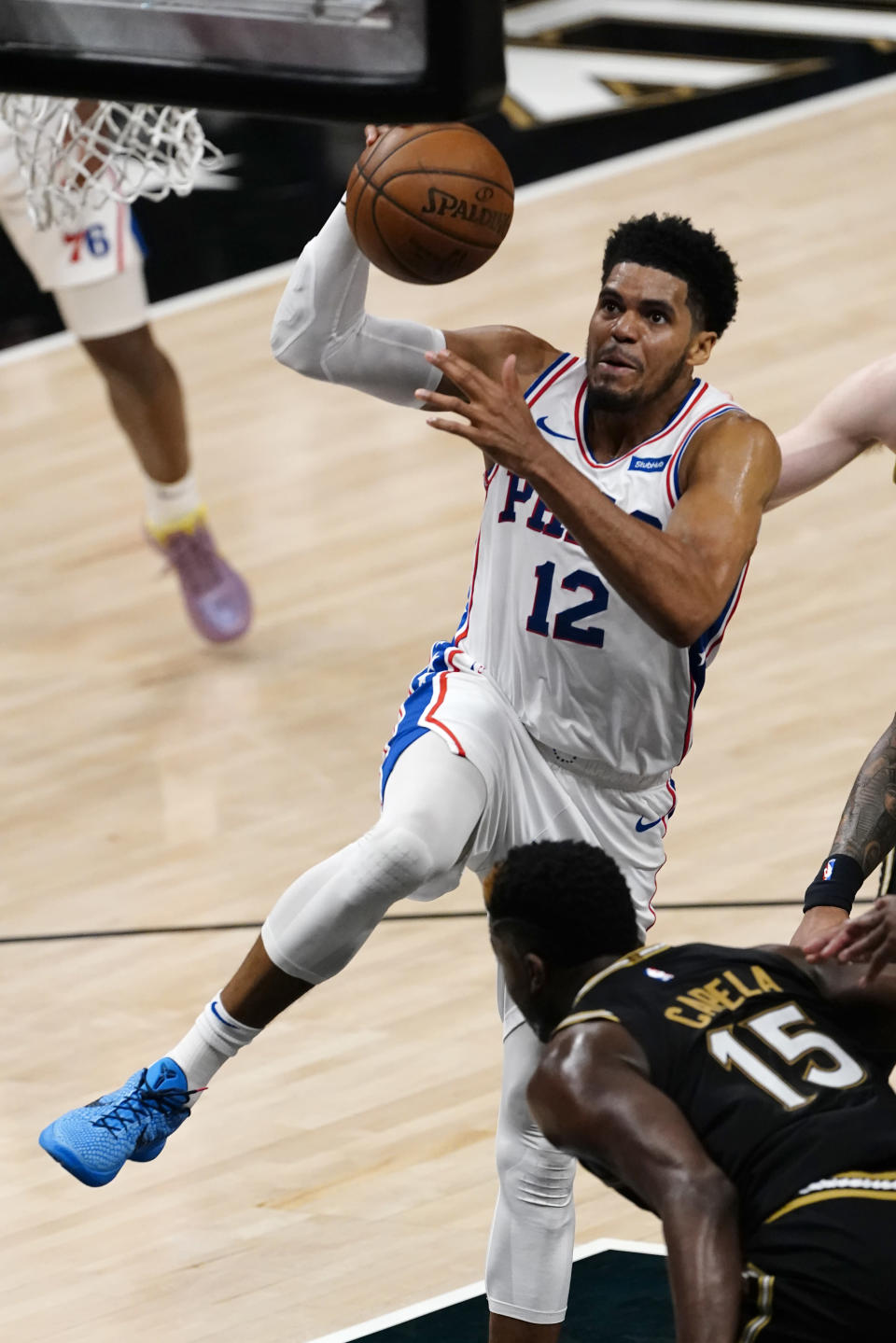Philadelphia 76ers forward Gary Clark (12) drives to the basket as Atlanta Hawks center Clint Capela (15) defends during the first half of Game 6 of an NBA basketball Eastern Conference semifinal series Friday, June 18, 2021, in Atlanta. (AP Photo/John Bazemore)