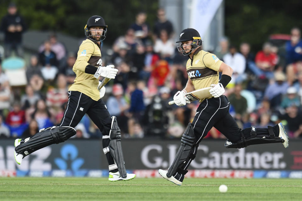 FILE - In this Feb. 22, 2021 file photo, New Zealand's Glenn Phillips, right, and Devon Conway run between the wickets during the first T20 cricket international between Australia and New Zealand at Hagley Oval in Christchurch, New Zealand. Phillips has been included for the first time on New Zealand Cricket's list of centrally contracted players. (John Davidson/Photosport via AP, File)