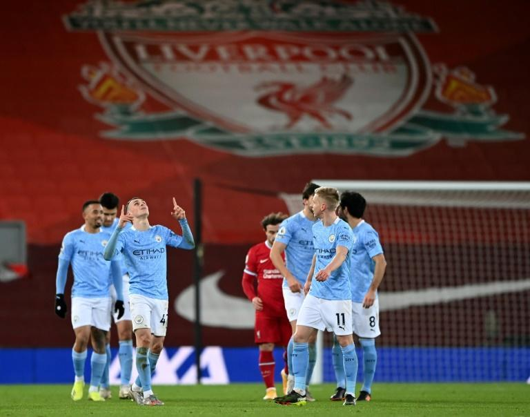 Phil Foden celebrates scoring at Anfield