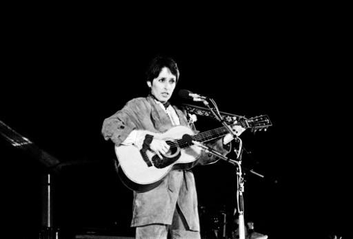 US folk singer and activist Joan Baez, shown here giving a concert on the parvis of Paris' Notre Dame cathedral in 1980, performed at 1969's Woodstock but did not see it as politically minded