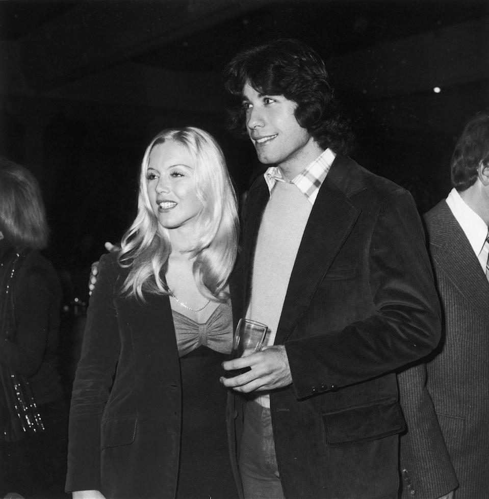 <p>The <em>Saturday Night Fever </em>star added a touch of festive cheer to his outfit with a buffalo plaid collared shirt under his sweater for Christmas party with his girlfriend, Lisa Farringer, at the Beverly Hilton Hotel. </p>