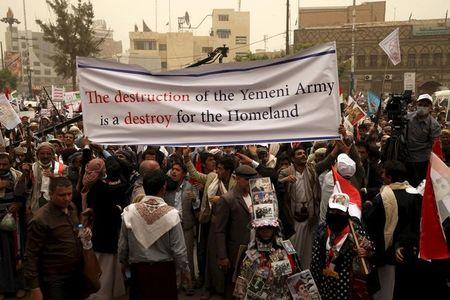 Supporters of Yemen's former President Ali Abdullah Saleh participate during a rally against air strikes in Sanaa