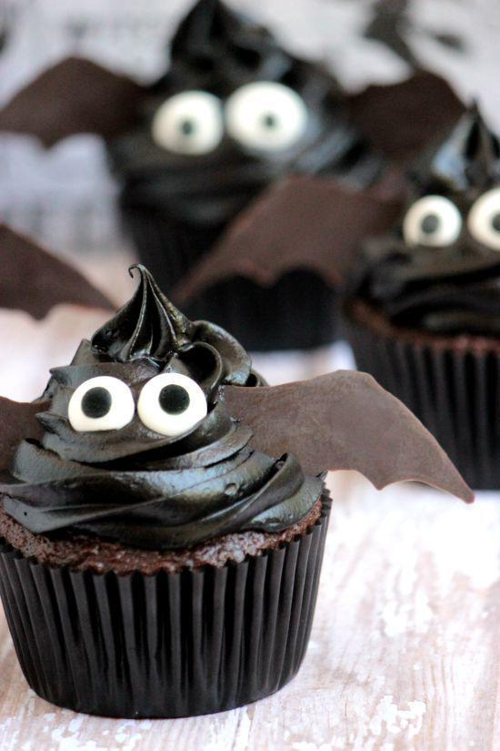 """<p>We <em>bat</em> you'll love these chocolate cupcakes. They're probably one of the easiest options to decorate!</p><p><strong>Get the recipe at <a href=""""https://www.bigbearswife.com/bat-cupcakes-thehalloweenproject/"""" rel=""""nofollow noopener"""" target=""""_blank"""" data-ylk=""""slk:Big Bear's Wife"""" class=""""link rapid-noclick-resp"""">Big Bear's Wife</a>.</strong></p><p><strong><a class=""""link rapid-noclick-resp"""" href=""""https://www.amazon.com/Wilton-710-0017-Candy-Eyeballs-88-oz/dp/B005BPU1P8/?tag=syn-yahoo-20&ascsubtag=%5Bartid%7C10050.g.1366%5Bsrc%7Cyahoo-us"""" rel=""""nofollow noopener"""" target=""""_blank"""" data-ylk=""""slk:SHOP EDIBLE EYES"""">SHOP EDIBLE EYES</a><br></strong></p>"""