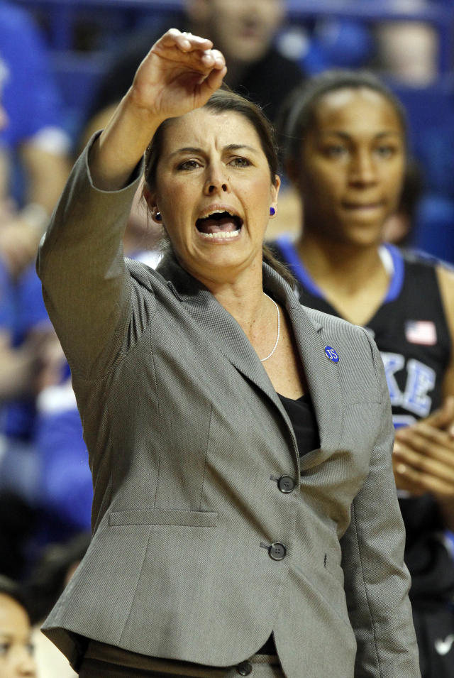 Duke coach Joanne P. McCallie calls a play during the second half of an NCAA college basketball game against Kentucky, Sunday, Dec. 22, 2013, in Lexington, Ky. Duke 69-61.(AP Photo/James Crisp)