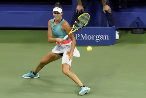 Jennifer Brady, of the United States, returns a shot to Naomi Osaka, of Japan, during a semifinal match of the US Open tennis championships, Thursday, Sept. 10, 2020, in New York. (AP Photo/Frank Franklin II)