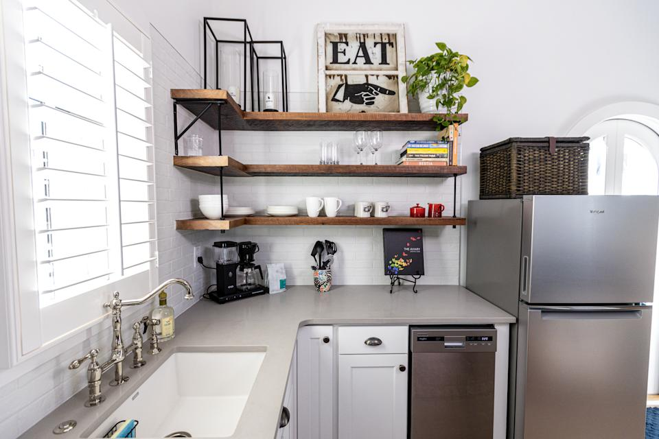 This Town at Trilith tiny house has a sleek, modern kitchen with downsized appliances.
