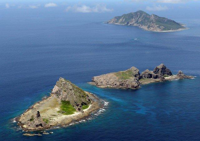 A group of disputed islands, Uotsuri island (top), Minamikojima (bottom) and Kitakojima, known as Senkaku in Japan and Diaoyu in China is seen in the East China Sea, in this photo taken by Kyodo September 2012. REUTERS/Kyodo/File Photo