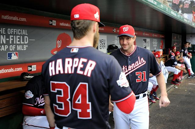 Bryce Harper and Max Scherzer will stare each other down in the batter's box Tuesday. (Photo by G Fiume/Getty Images)