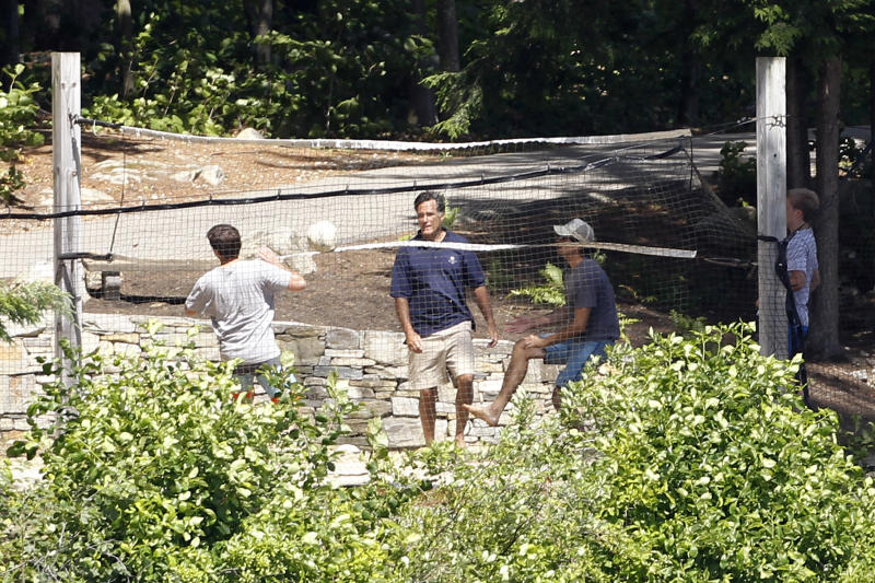 Republican presidential candidate, former Massachusetts Gov. Mitt Romney, center, plays volleyball with his sons Craig, right, and Tagg, left, at their vacation home on Lake Winnipesaukee in Wolfeboro, N.H., Tuesday, July 3, 2012. (AP Photo/Charles Dharapak)