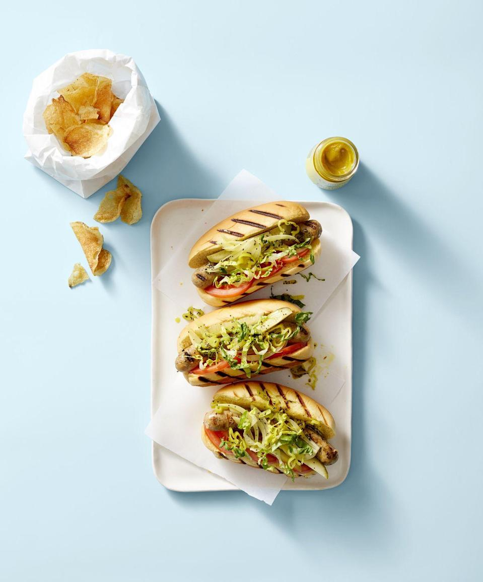 "<p>Sweet and spicy pickles and peppers make this barbecue favorite a real winner.</p><p><em><a href=""https://www.goodhousekeeping.com/food-recipes/easy/a28210516/chicago-style-chicken-dogs-recipe/"" rel=""nofollow noopener"" target=""_blank"" data-ylk=""slk:Get the recipe for Chicago-Style Chicken Dogs »"" class=""link rapid-noclick-resp"">Get the recipe for Chicago-Style Chicken Dogs »</a></em></p>"