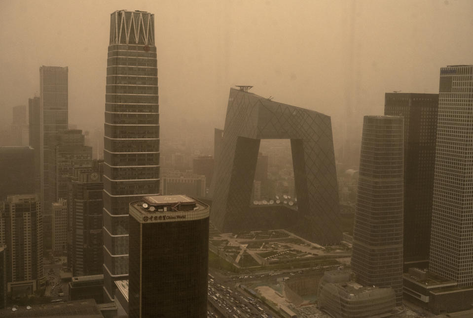 BEIJING, CHINA - April 15: The Central Business District is seen during a seasonal sandstorm on April 15, 2021 in Beijing, China. China's capital and the northern part of the country typically experience sandstorms that originate in the Gobi desert, but scientists believe that climate change and desertification also plays a role in their frequency and intensity. (Photo by Kevin Frayer/Getty Images)