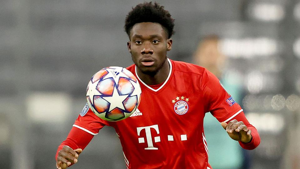 Pictured here, Bayern Munich star Alphonso Davies prepares to control a ball during a match.