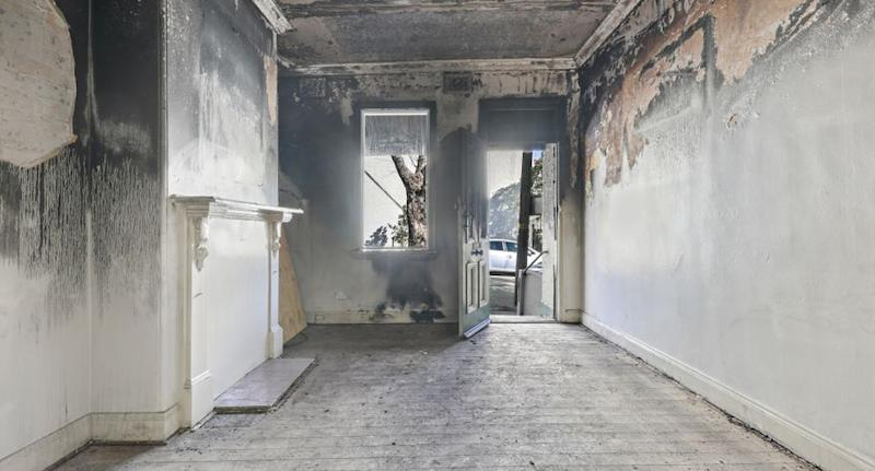 Inside of a fire-bombed home on Campbell Street, Glebe in Sydney.