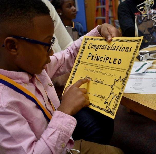 PHOTO: Antonio, 6, with a certificate awarded to him for his integrity and honesty at school. (Kanesha Burch)