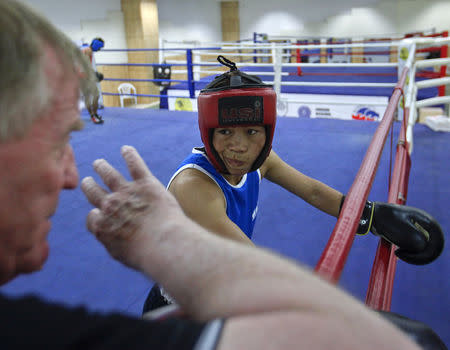 FILE PHOTO: India's boxer MC Mary Kom listens to her coach during a training session at Balewadi Stadium in Pune, about 190 km (118 miles) from Mumbai, March 12, 2012. REUTERS/Danish Siddiqui