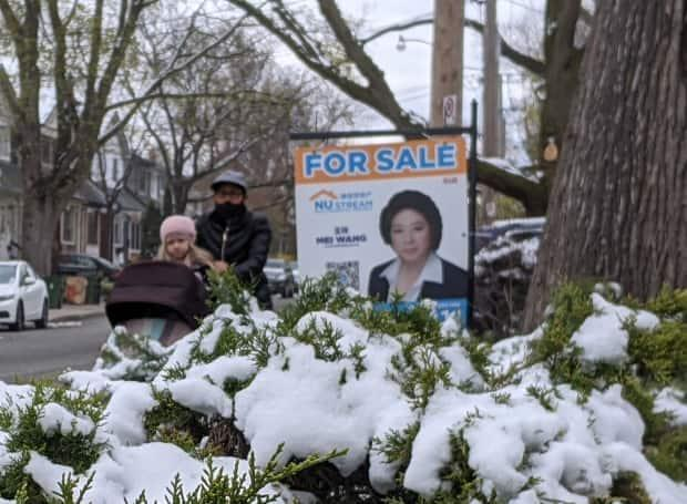 A spring snowstorm in parts of Canada may do little to cool house prices, but the prospect of rising rates could have a bigger effect, even as the economy booms. (Don Pittis/CBC - image credit)