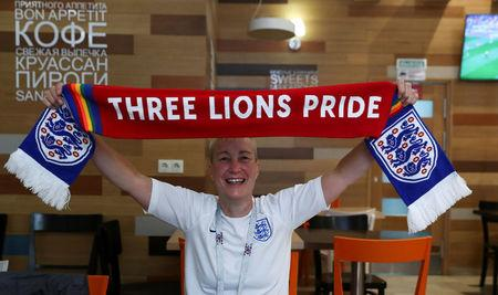 England's fan and LGBT rights campaigner Di Cunningham displays a scarf during an interview with Reuters in Volgograd, Russia, June 18 2018. REUTERS/Sergio Perez