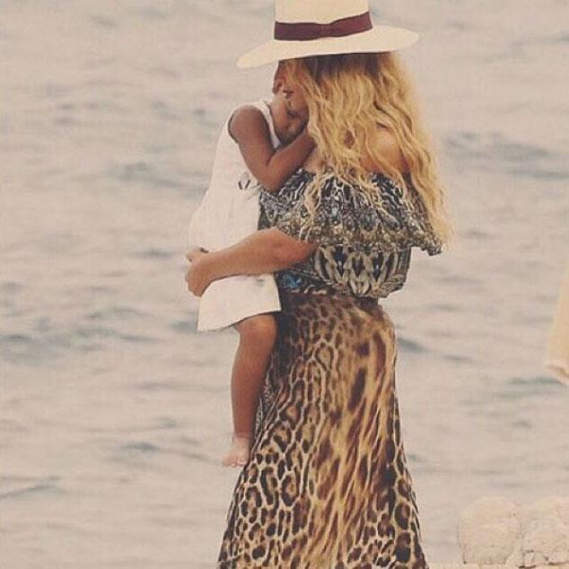 <p>Snuggling up to mom during a walk on the beach, Blue Ivy looks absolutely content. </p>