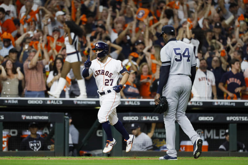 Houston Astros' Jose Altuve celebrate after a two-run home run off New York Yankees pitcher Aroldis Chapman to win Game 6 of baseball's American League Championship Series against the New York Yankees Saturday, Oct. 19, 2019, in Houston. The Astros won 6-4 to win the series 4-2. (AP Photo/Matt Slocum)