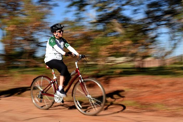 During the impeachment trial, Dilma Roussef would escape to Porto Allegre where she'd bicycle and see family (AFP Photo/Evaristo Sa)