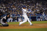 Los Angeles Dodgers' Justin Turner drives in two-runs with a double during the first inning of a baseball game against the Arizona Diamondbacks Monday, Sept. 13, 2021, in Los Angeles. (AP Photo/Marcio Jose Sanchez)