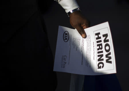 FILE PHOTO - A man holds a leaflet at a military veterans' job fair in Carson, California October 3, 2014. REUTERS/Lucy Nicholson