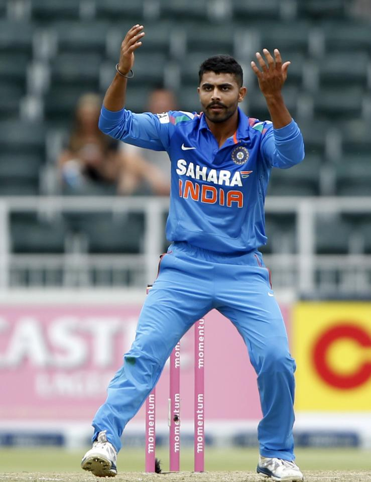 India's Ravindra Jadeja gestures during their 1st One-Day International (ODI) against South Africa in Johannesburg, December 5, 2013. REUTERS/Siphiwe Sibeko (SOUTH AFRICA - Tags: SPORT CRICKET)