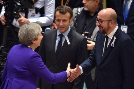French President Macron and Belgian PM Michel welcome British PM May during a EU leaders summit in Brussels