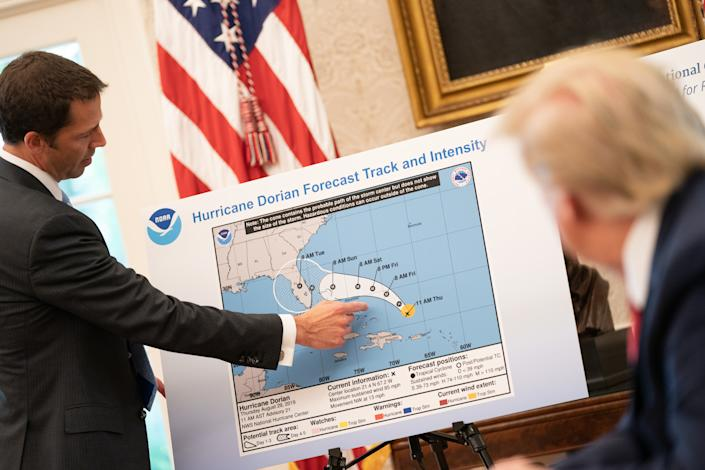 President Trump receives a briefing on Hurricane Dorian in the Oval Office on Thursday. (Official White House Photo by Shealah Craighead)
