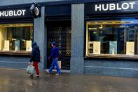 People walk past a shop of LVMH's Hublot watch brand in Zurich