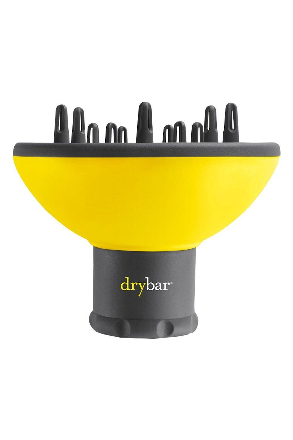 """<p><strong>Drybar</strong></p><p>amazon.com</p><p><strong>$34.00</strong></p><p><a href=""""https://www.amazon.com/dp/B06X9MHL9C?tag=syn-yahoo-20&ascsubtag=%5Bartid%7C10049.g.29369638%5Bsrc%7Cyahoo-us"""" rel=""""nofollow noopener"""" target=""""_blank"""" data-ylk=""""slk:Shop Now"""" class=""""link rapid-noclick-resp"""">Shop Now</a></p><p>Although this diffuser is technically designed for Drybar's iconic <a href=""""https://www.amazon.com/DRYBAR-Buttercup-Drybar-Blow-Dryer/dp/B00BIGARH6"""" rel=""""nofollow noopener"""" target=""""_blank"""" data-ylk=""""slk:Buttercup blow dryer"""" class=""""link rapid-noclick-resp"""">Buttercup blow dryer</a>, it can actually fit any blow dryer that has a nozzle diameter of 2 inches (a common nozzle size). <strong>Its staggered prongs also make it easy to catch and dry curls of any length</strong> without them slipping. Pro tip: Gather a clump of your damp curls with your hand and gently place the entire bundle on top of the bowl—rather than mashing the diffuser to your head—to help define your pattern.</p>"""