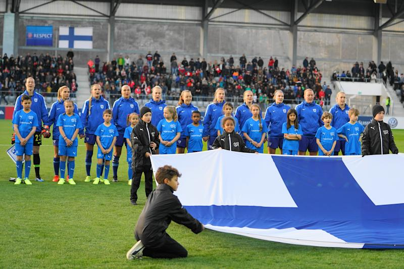 BIEL, SWITZERLAND - APRIL 05: Team of Finland behind the Finland flag during their national anthem prior the international friendly football match between Switzerland Women and Finland Women at Tissot-Arena on April 5, 2019 in Biel, Switzerland. (Photo by Daniela Porcelli/Getty Images)