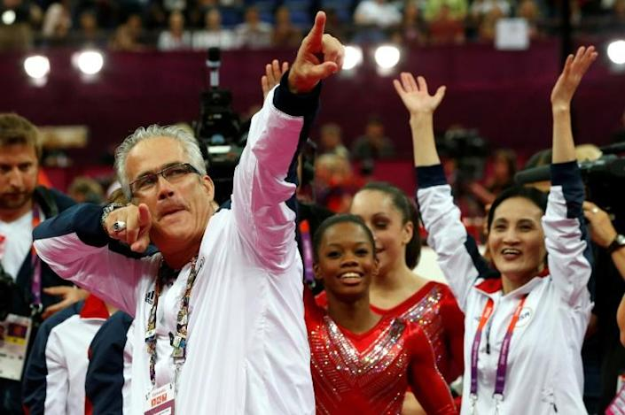 Former US women gymnastics team's coach John Geddert, pictured July 2012, was charged with sexual assault and treatment of young gymnasts that constituted human trafficking