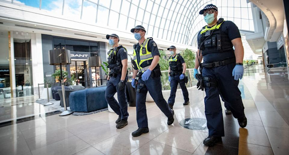 Pictured are Victoria Police officers at Chadstone Shopping Centre on September 20, 2020 in Melbourne, Australia.