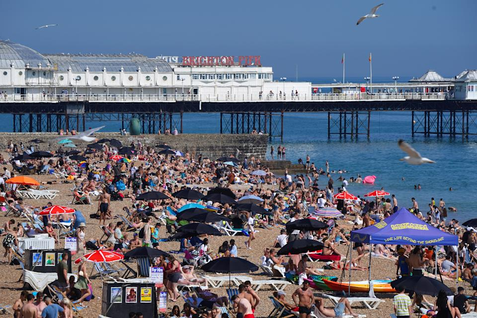 People enjoying the sunshine on Brighton beach. Wednesday could be the hottest day of the year so far as parts of the UK are set to bask in 30-degree heat. Picture date: Wednesday June 16, 2021.