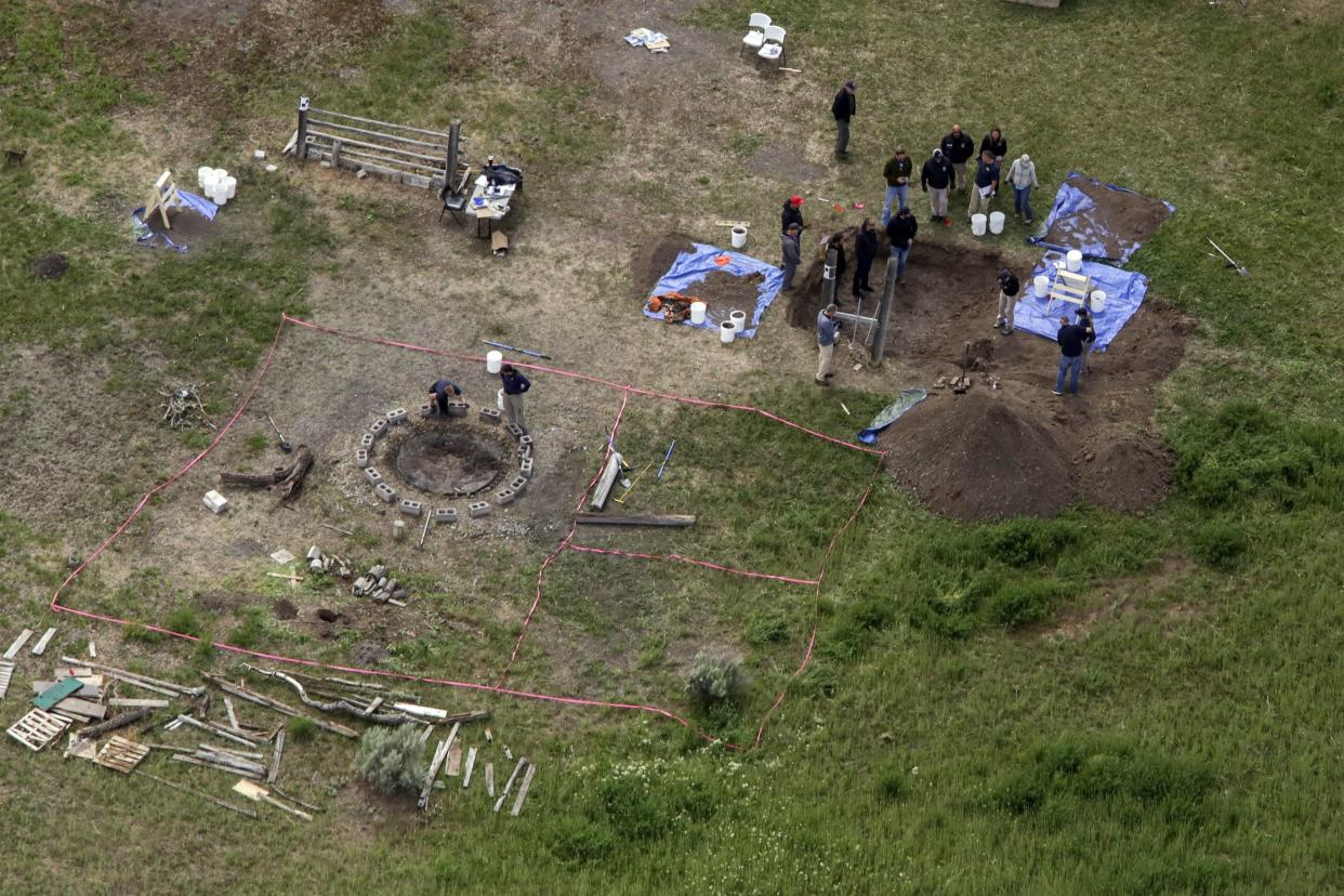 In this aerial photo, investigators search for human remains at Chad Daybell's residence on Tuesday, June 9, 2020, in Salem, Idaho.