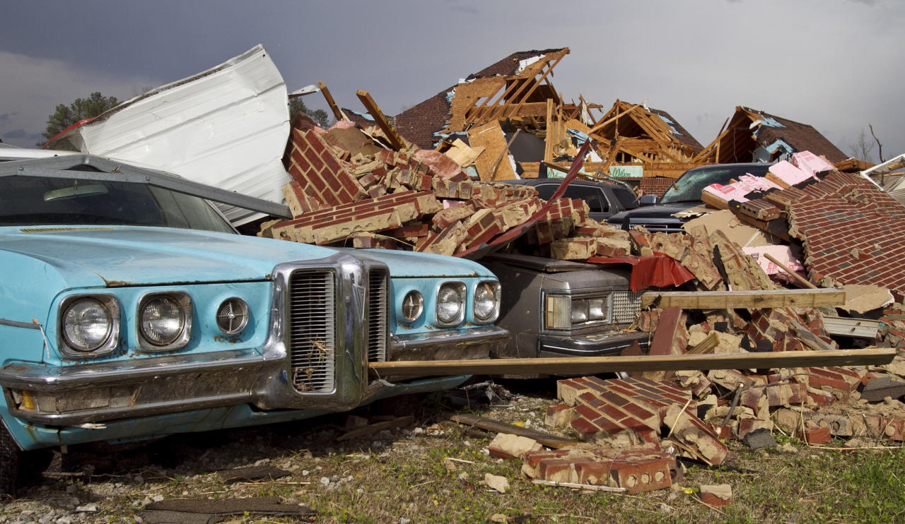 A tornado left a path of destruction as it passed through Friday, March 2, 2012, in Athens, Ala. Powerful storms stretching from the Gulf Coast to the Great Lakes flattened buildings in several states, wrecked two Indiana towns and bred anxiety across a wide swath of the country in the second powerful tornado outbreak this week. (AP Photo/Butch Dill)