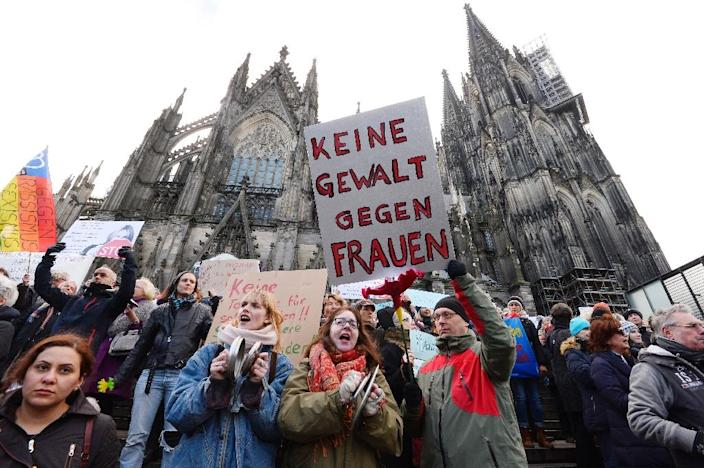 People take part in a demonstration on January 9, 2016, in front of the Cologne cathedral in western Germany, where sexual assaults by a group of migrants took place on New Year's Eve (AFP Photo/Roberto Pfeil)
