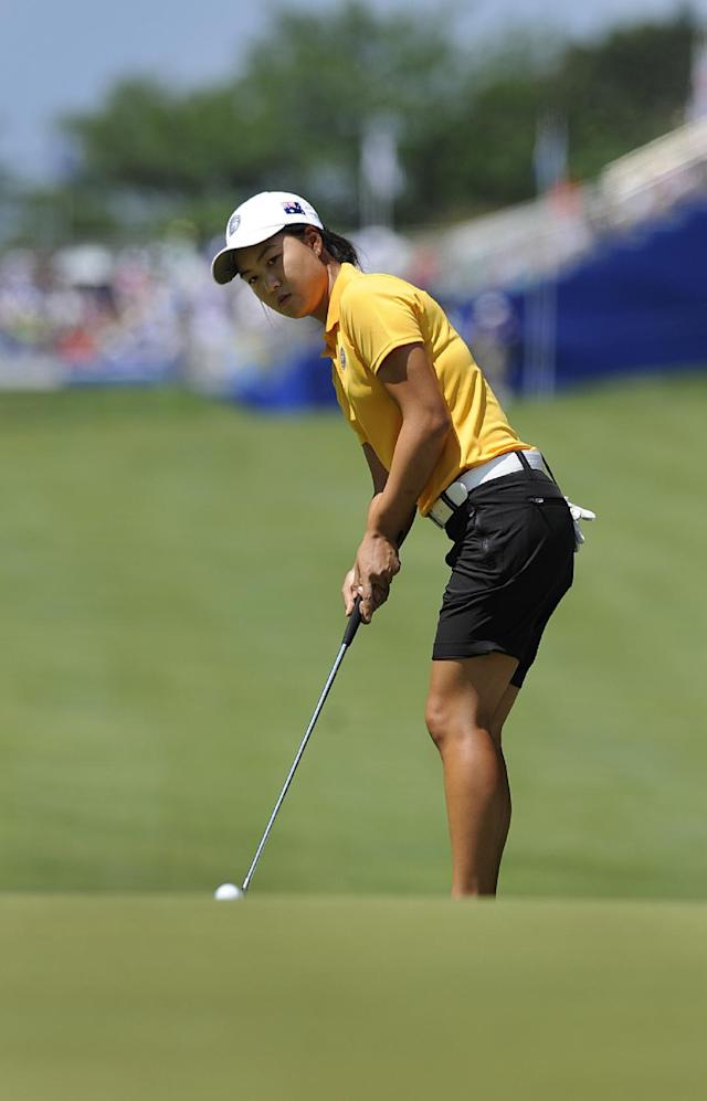 Minjee Lee, of Australia, chips onto the first hole during the third round of the International Crown golf tournament on Saturday, July 26, 2014, in Owings Mills, Md.(AP Photo/Gail Burton)