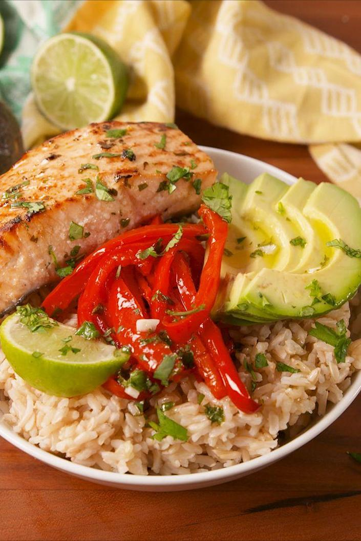 "<p>Eating healthy doesn't have to be boring!</p><p>Get the recipe from <a href=""https://www.delish.com/cooking/recipe-ideas/recipes/a58003/cilantro-lime-salmon-bowls-recipe/"" rel=""nofollow noopener"" target=""_blank"" data-ylk=""slk:Delish"" class=""link rapid-noclick-resp"">Delish</a>.</p><p><a class=""link rapid-noclick-resp"" href=""https://www.amazon.com/Delish-Like-Every-Days-Weekend/dp/1328498867?tag=syn-yahoo-20&ascsubtag=%5Bartid%7C1782.g.3733%5Bsrc%7Cyahoo-us"" rel=""nofollow noopener"" target=""_blank"" data-ylk=""slk:BUY NOW"">BUY NOW</a> <strong><em>Delish Cookbook, amazon.com </em></strong> </p>"