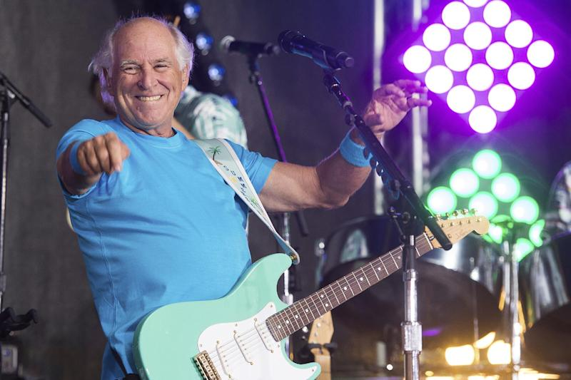 "FILE - This July 29, 2016 file photo shows Jimmy Buffett performing on NBC's ""Today"" show in New York.  Buffett is opening a retirement village. Jimmy Buffet's Latitude Margaritaville will open its first community in Daytona Beach, Fla., in the fall. (Photo by Charles Sykes/Invision/AP, File)"