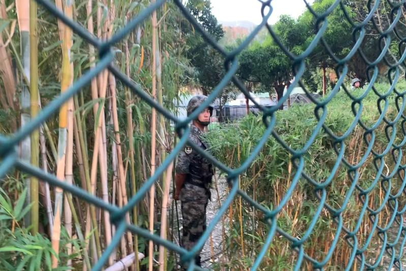 People's Liberation Army (PLA) soldier stands guard inside Osborn Barracks in Kowloon Tong