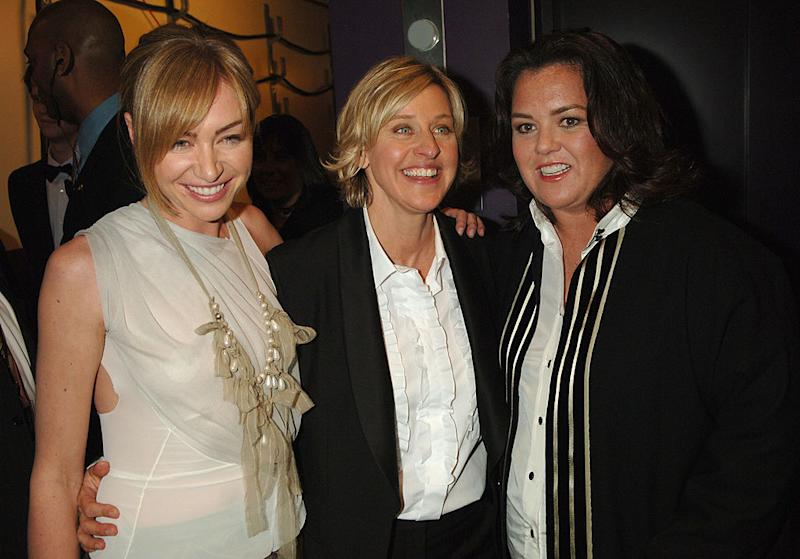 Actress Portia de Rossi and wife Ellen DeGeneres mingle with Rosie O'Donnell in 2006. (Photo: Jeff Kravitz/FilmMagic)