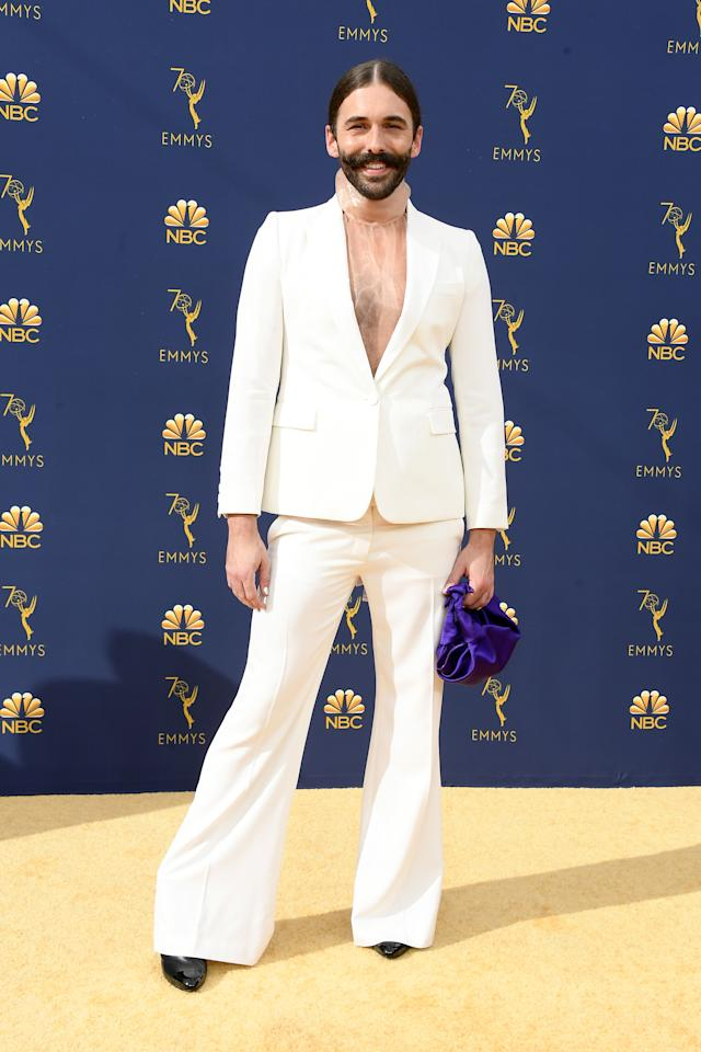 <p>The <em>Queer Eye </em>star stunned on the carpet in a white power suit over a sheer turtleneck. (Photo: Getty Images) </p>