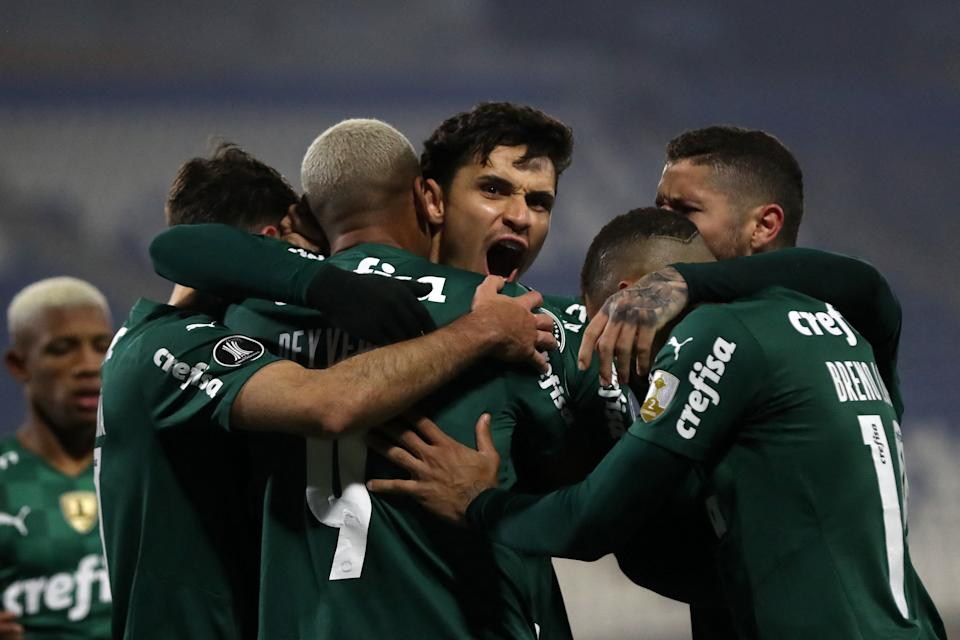 Brazil's Palmeiras Raphael Veiga (C) celebrates with teammates after scoring a goal during his Copa Libertadores round of 16 first leg football match against Chile's Universidad Catolica at San Carlos de Apoquindo stadium in Santiago, on July 14, 2021. (Photo by PABLO SANHUEZA / POOL / AFP) (Photo by PABLO SANHUEZA/POOL/AFP via Getty Images)