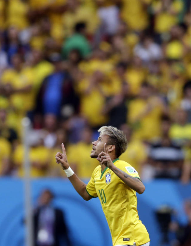 Brazil's Neymar celebrates scoring the opening goal during the group A World Cup soccer match between Cameroon and Brazil at the Estadio Nacional in Brasilia, Brazil, Monday, June 23, 2014. (AP Photo/Dolores Ochoa)