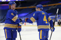 Buffalo Sabres forward Taylor Hall (4) right celebrates his goal with teammate Jack Eichel (9) during the first period of an NHL hockey game against the Washington Capitals, Thursday, Jan. 14, 2021, in Buffalo, N.Y. (AP Photo/Jeffrey T. Barnes)