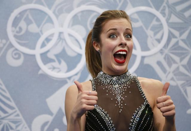 """Ashley Wagner of the U.S. reacts in the """"kiss and cry"""" area during the Figure Skating Women's Short Program at the Sochi 2014 Winter Olympics, February 19, 2014. REUTERS/Lucy Nicholson (RUSSIA - Tags: OLYMPICS SPORT FIGURE SKATING)"""