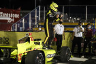 Simon Pagenaud, of France, celebrates in Victory Lane after winning an IndyCar Series auto race Friday, July 17, 2020, at Iowa Speedway in Newton, Iowa. (AP Photo/Charlie Neibergall)