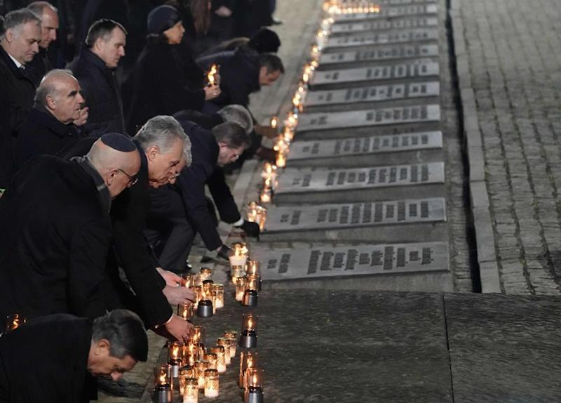 Heads of state and survivors attend the candle-lighting ceremony.